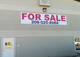 Large For Sale Banner on Stucco