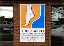 Metal Foot and Ankle Sign on Brick Building