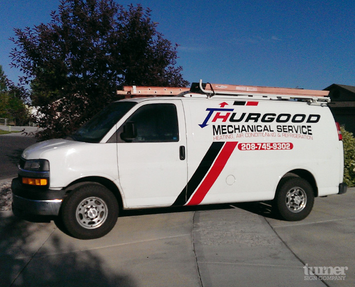 Black and red chevy van graphics with large stripe