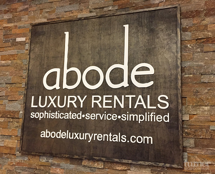 Abode 3d Letters on Wooden Background Lobby Sign